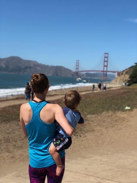 natural birth mom holding baby by golden gate bridge