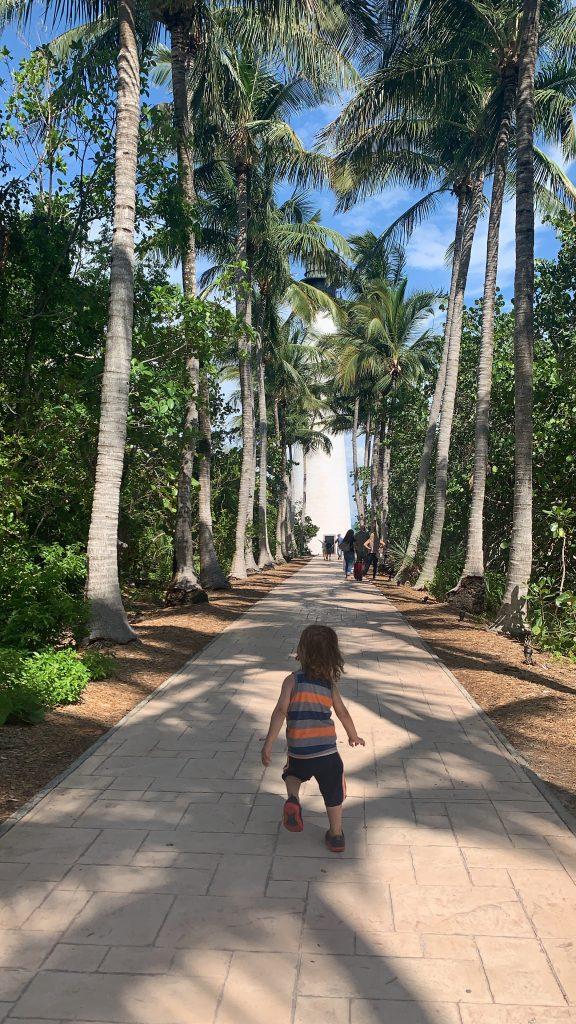 toddler running towards lighthouse