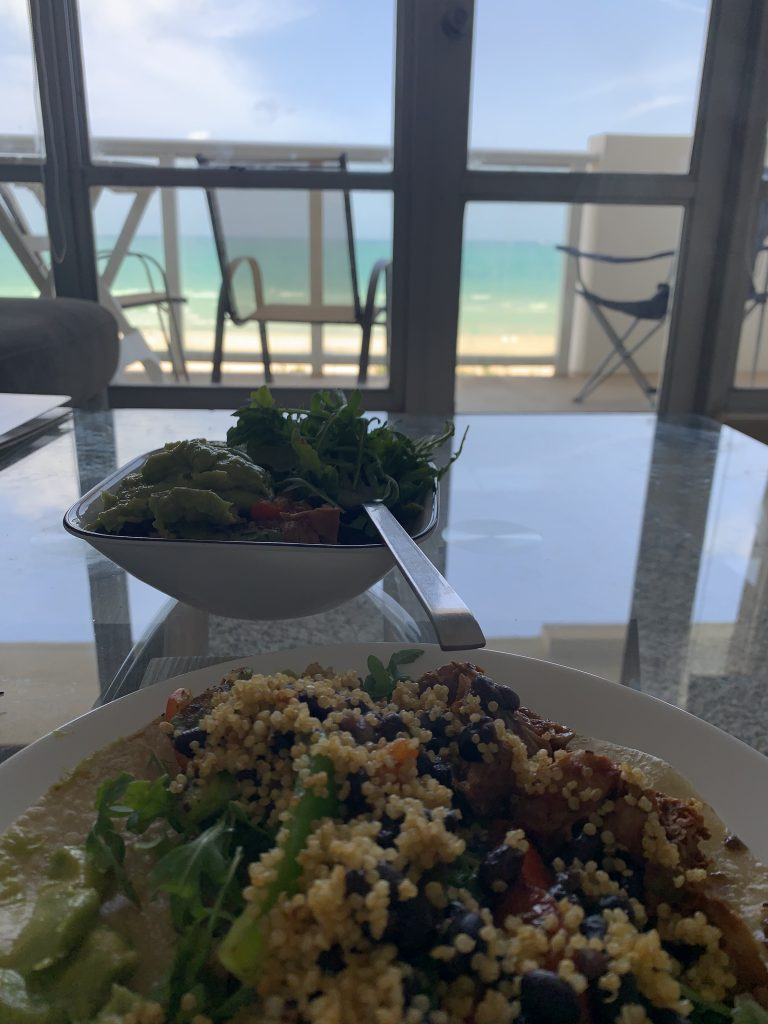 Miami Beach taco and bowl with ocean balcony view