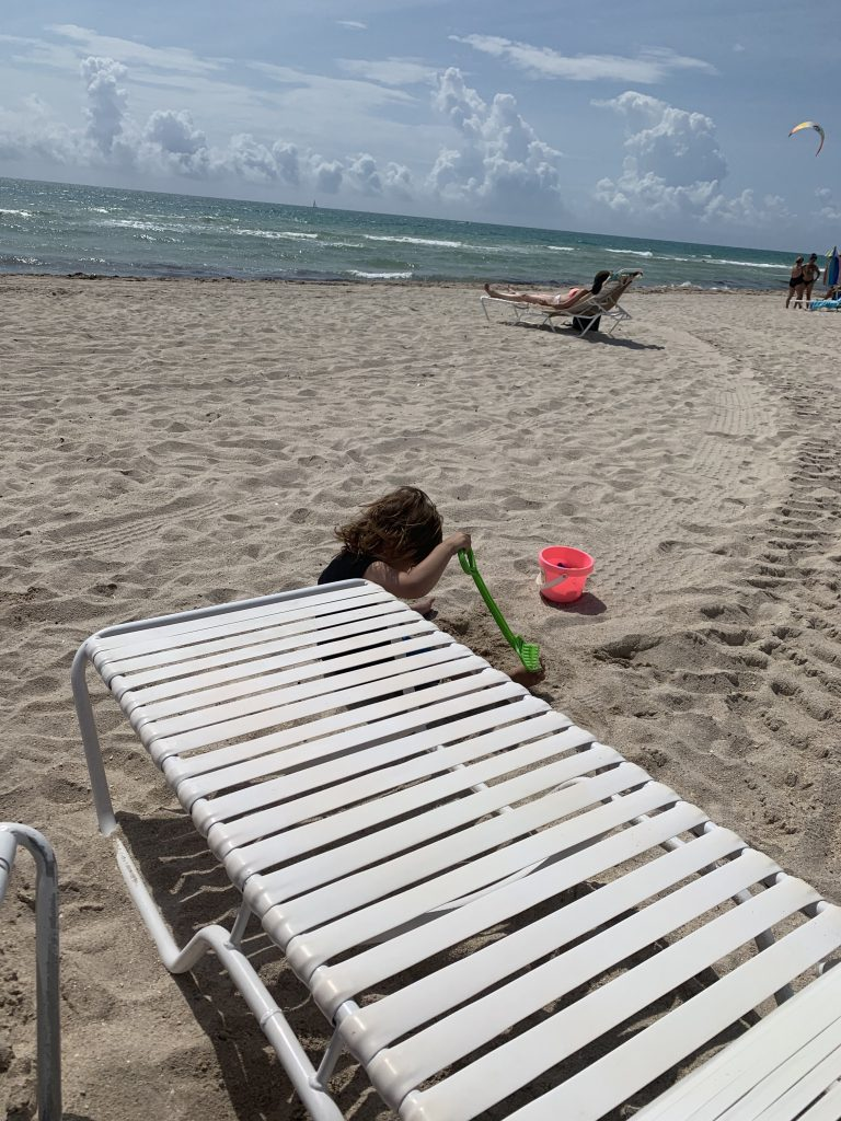 child playing in the sand at Miami Beach