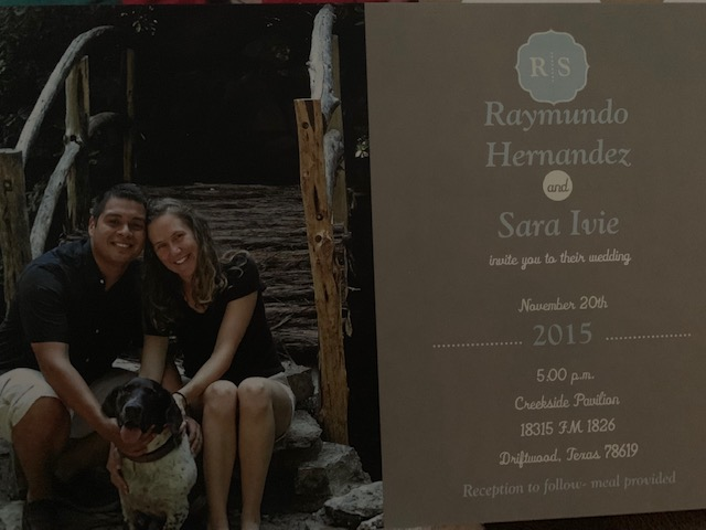 Wedding invitation with bride and groom to be posing with their dog