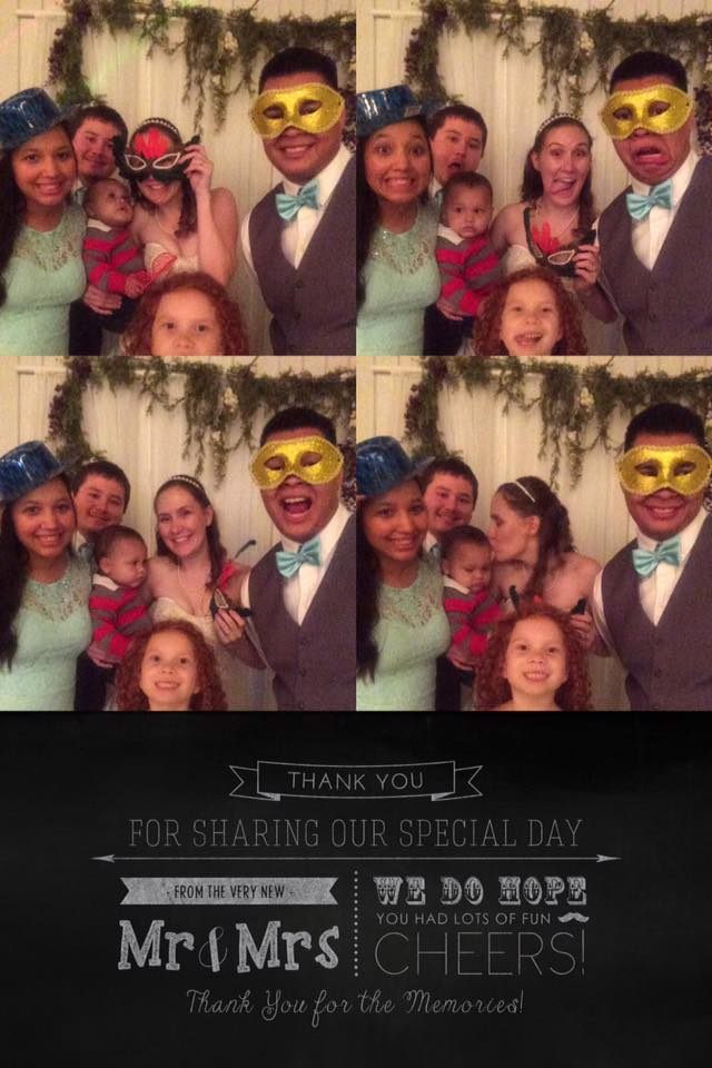 Wedding Photo Booth with bride and groom and friends posing with props (masks, hats)
