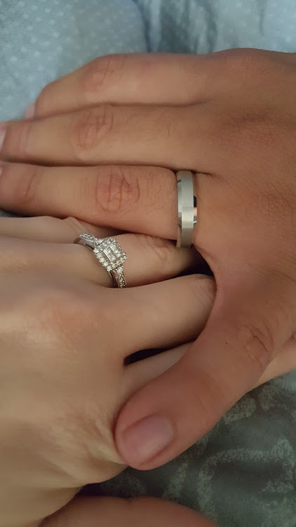 Bride and groom's hands with wedding bands